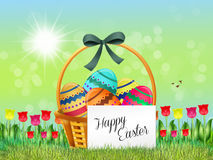Easter chocolate eggs in the basket Royalty Free Stock Photography
