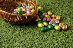 Easter chocolate eggs basket Stock Photo