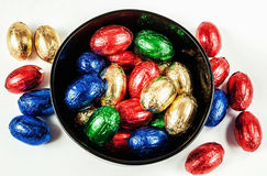Easter chocolate colorful eggs in black bowl Stock Photography