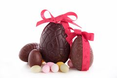 Easter chocolate eggs. And bow Royalty Free Stock Images