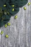 Easter chocolate eggs in foil with green fabric on gray wooden background. Easter chocolate eggs in foil with green fabric on gray wooden background Stock Image