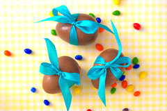 Easter chocolate eggs with turquoise ribbon bow Stock Images