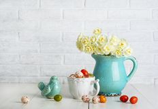 Easter chocolate eggs in the white cup royalty free stock photos