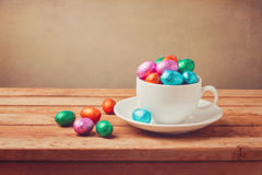 Easter chocolate eggs on wooden table. Retro filter effect Stock Photography