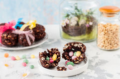 Easter Chocolate and Puffed Wheat Egg with Surprise Stock Images