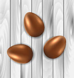 Easter chocolate three eggs on grey wooden background Stock Images