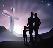 Easter Christian Cross Family. A Christian family with a cross in a mountain landscape and a sunrise, Christian family life or Easter concept Royalty Free Stock Photography