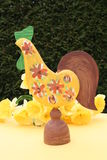 Easter cock. Of wood with Daffodils behind Stock Photography