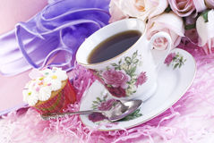 Easter Coffee with Cupcake. A hot cup of coffee with Easter decorations and a delicious cupcake, horizontal with selective focus Stock Photos