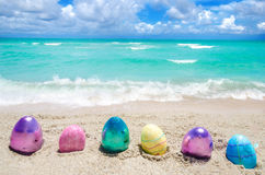 Easter color eggs on the beach near ocean Stock Images