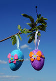 Easter color eggs on blue sky Royalty Free Stock Image