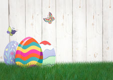 Easter color eggs with butterfly in the garden. Digital composite of Easter color eggs with butterfly in the garden Stock Photography