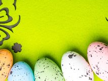 Easter color eggs on green background, free space for text royalty free stock photos