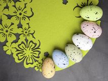 Easter color eggs on green background, free space for text royalty free stock images