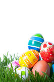 Easter color eggs on green grass Stock Photos