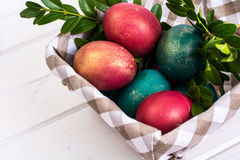 Easter, color painted eggs on white boards Royalty Free Stock Photo