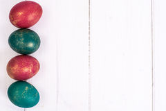 Easter, color painted eggs on white boards Stock Images