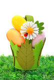 Easter colored cloth eggs, an ox-eye daisy in the basket Stock Photography