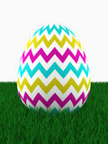 Easter colored egg lying on grass Royalty Free Stock Photography