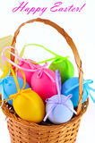 Easter colored eggs in the basket. Happy Easter! Stock Image