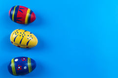 Easter colored eggs. On blue background Royalty Free Stock Photos