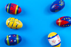 Easter colored eggs. On blue background Stock Images