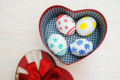 Easter colored eggs in a box in the shape of heart Royalty Free Stock Photos