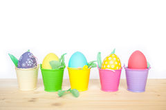 Easter colored eggs in colorful buckets Stock Photography