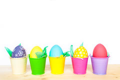 Easter colored eggs in colorful buckets Royalty Free Stock Photo
