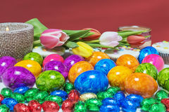 Easter colored eggs cupcake with a candle Stock Photo
