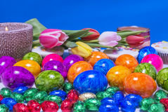 Easter colored eggs cupcake with a candle Royalty Free Stock Image