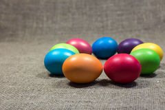 Easter colored eggs on dark green rough cotton texture art conce Stock Image