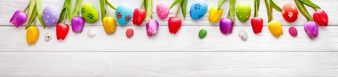 Easter Eggs with Flowers On Wood Background. Easter Colored Eggs with Flowers on White Wood Background royalty free stock photos