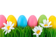 Easter colored eggs on the grass. Royalty Free Stock Images