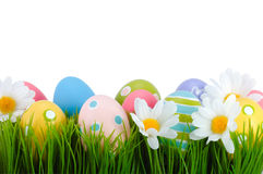 Easter colored eggs on the grass. Royalty Free Stock Photos