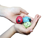 Easter colored eggs in the hands of the child. Royalty Free Stock Photos
