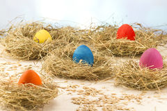 Easter colored eggs in the hay. Little newborn chick. Easter eggs in the hay. Little newborn chick on the blackboard Stock Photo