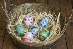 Easter colored eggs in the nest Royalty Free Stock Photography