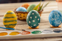 Easter colored eggs and paints Royalty Free Stock Photos