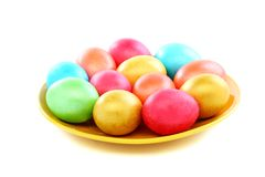 Easter colored eggs on a plate. Stock Images