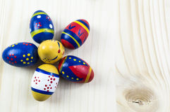 Easter colored eggs. On wooden background Royalty Free Stock Photography