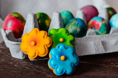 Easter. Colorful easter cookies and hand painted eggs on wooden background stock images