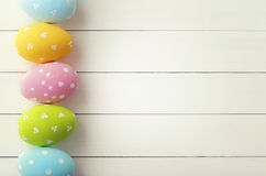 Easter. Colorful decorated easter eggs on wooden background stock image