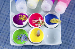 Easter colorful decoration and spring flowers plus egg shells and paints on a blue ceramic tray. Easter colorful decoration and spring flowers plus egg shells stock photo