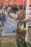 Straw hare and colorful easter eggs - outside decoration royalty free stock photography
