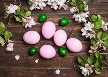 Easter. Colorful Easter eggs with spring blossom flowers on rust Stock Images