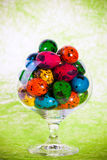 Easter colorful eggs in glass Stock Photography