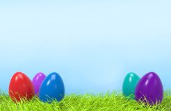 Easter colorful eggs on green grass and blue background. Easter colorful eggs in green grass and blue sky background with empty space for text. 3D illustration Royalty Free Stock Photography