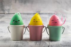 Easter colorful eggs in a line on white wood rustic background. Close Up with copy space stock images