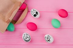 Easter colorful eggs and paper bag. royalty free stock photo